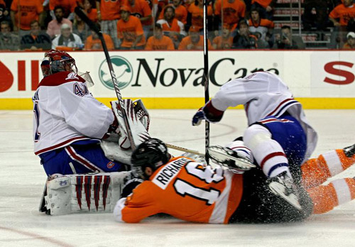 Halak,Richards, Hamrlik collide