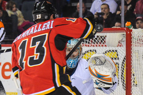 Alex Stalock faces a shot from Mike Cammaleri of the Calgary Flames, March 24, 2014 (From NHL.com)